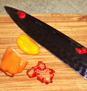 Sliced Reaper, little Ghost Pepper, and half a Habanero